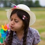 Girl Blowing Pinwheel 800 X 600
