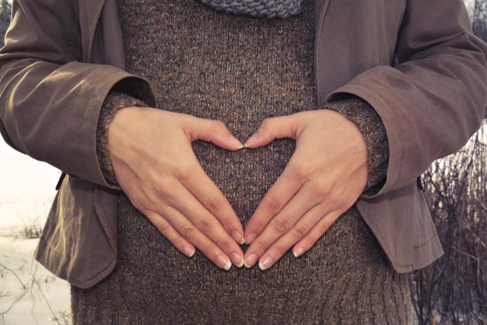 Atntpwmgrb2tay4q9ftf pregnant woman heart hands