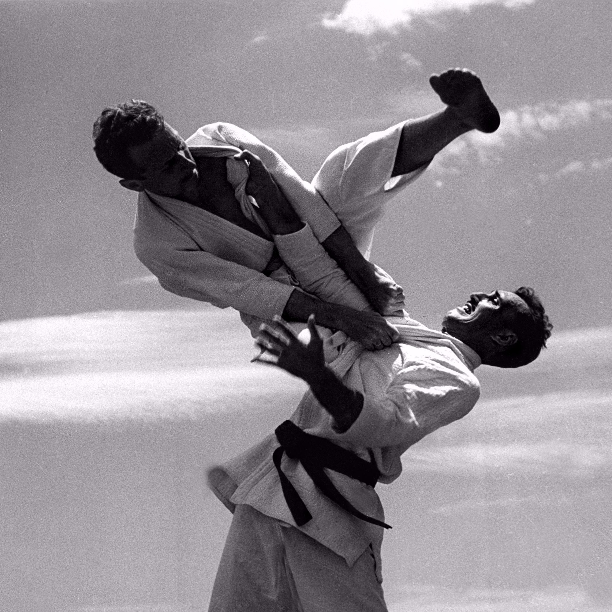 Brazilian Jiu-Jitsu Grand Master Carlos Gracie applies a flying armbar on his brother GM Helio Gracie on the 1960s. Under their leadership, BJJ became a powerful tool to help millions of people all over the world.