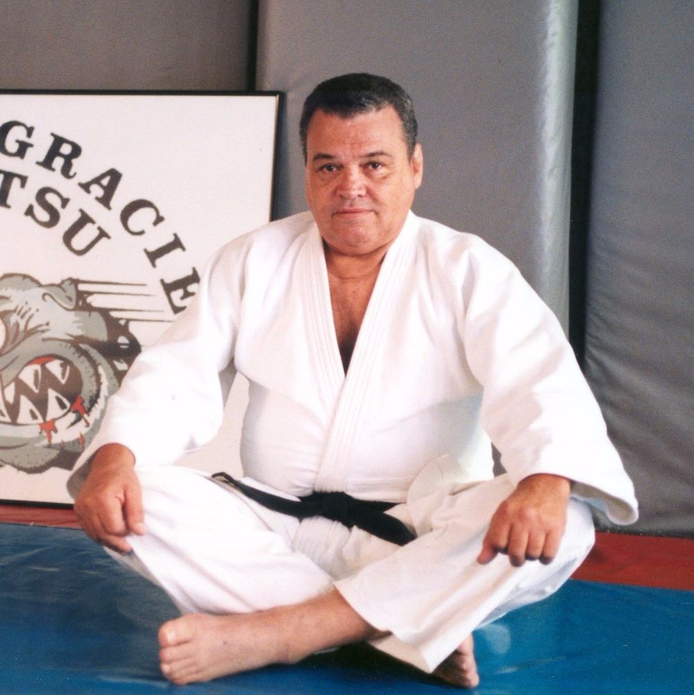 "BJJ Grand Master Carlson Gracie in a photo taken at his infamous school in Copacabana, Rio de Janeiro for a celebration of a Brazilian Jiu-Jitsu Nationals excellent result achieved by the union of his students in 1999. Learn more about Carlson <a href=""http://www.bjjheroes.com/bjj-fighters/carlson-gracie-profile"">here</a>."