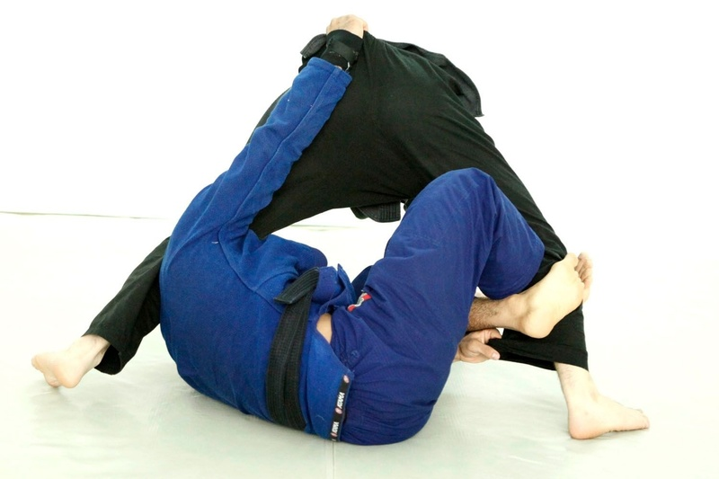 Extend his leg using the X-guard and grab hold of the pants leg