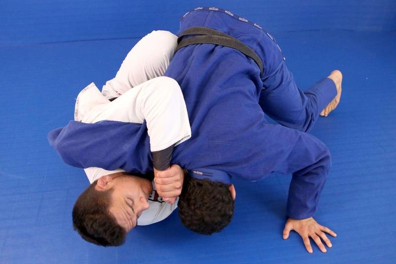 Rafael dos Anjos teaches a half-guard sweep