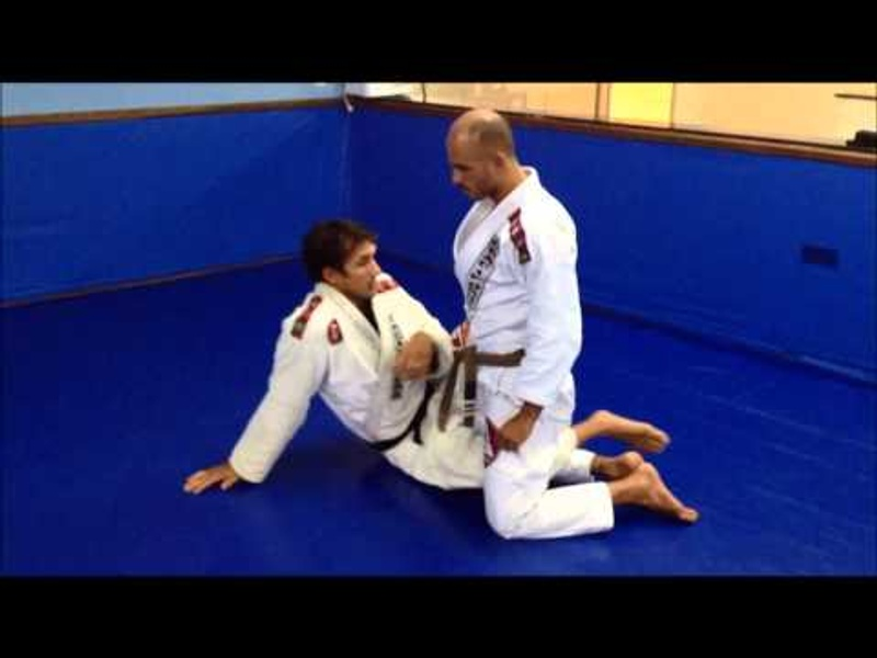 Brazilian Jiu-Jitsu lesson: Half guard sweep to anaconda choke