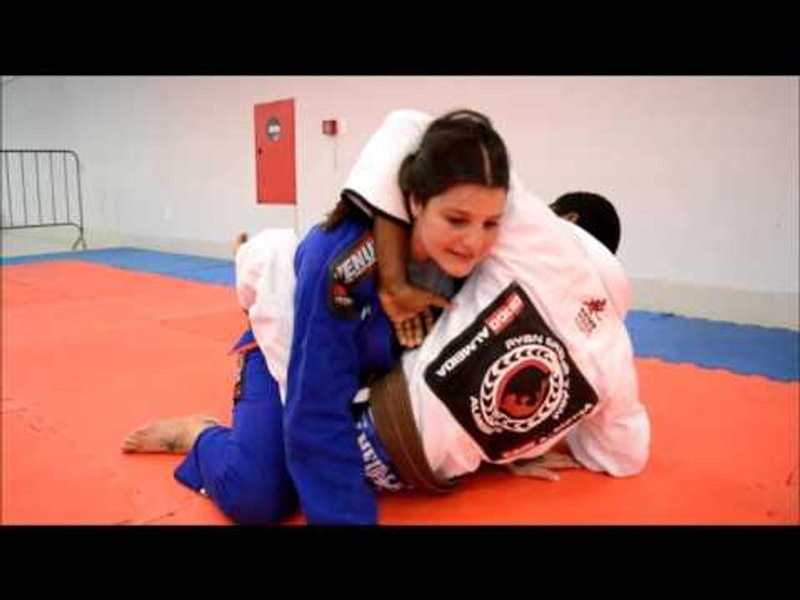 BJJ lesson: Learn from Talita Treta how to sink the Von Flue choke when defending against a guillotine