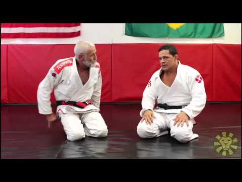 Study the wrist lock with red-and-black-belt Fabio Santos