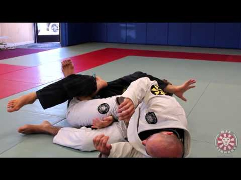 Clark Gracie teaching calf slicer against de la riva hook