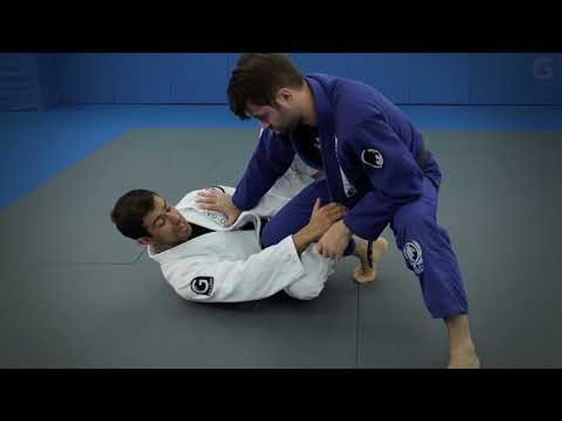 X-guard sweep against the knee-slicing pass