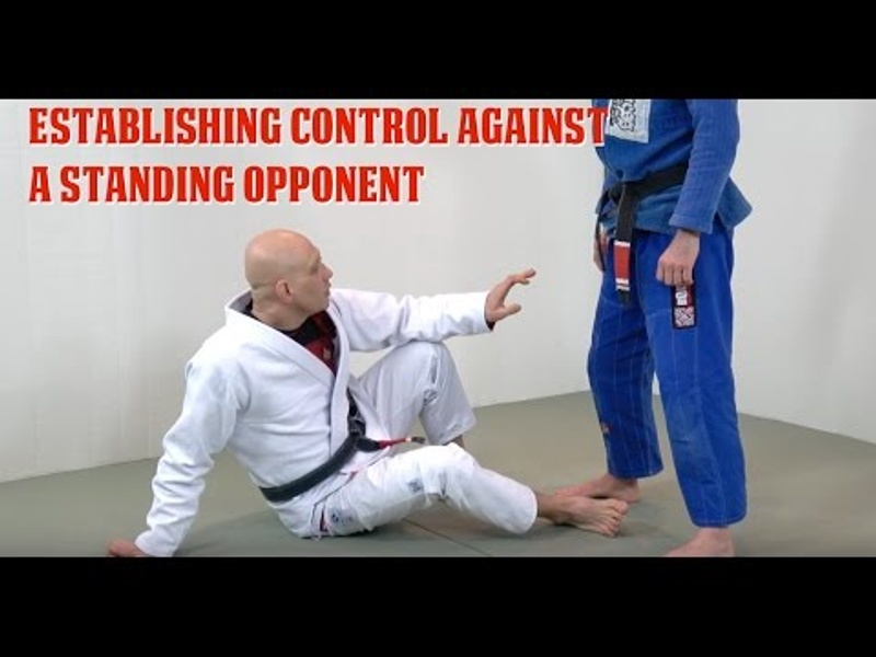 BJJ: How to be in control when your foe is standing and you're playing guard