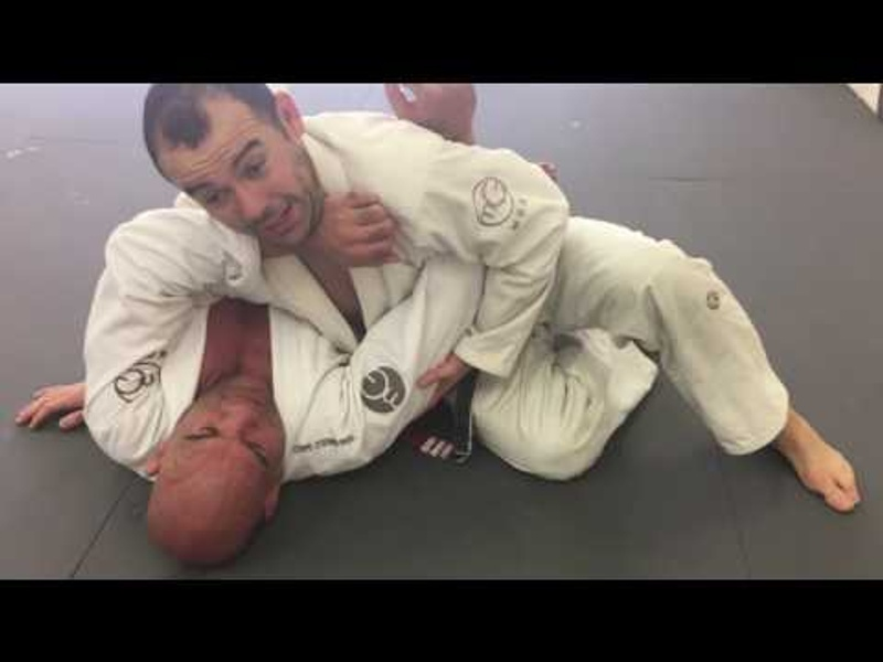 BJJ: Marcelo Garcia teaches how to pass the half-guard and finish on the armbar