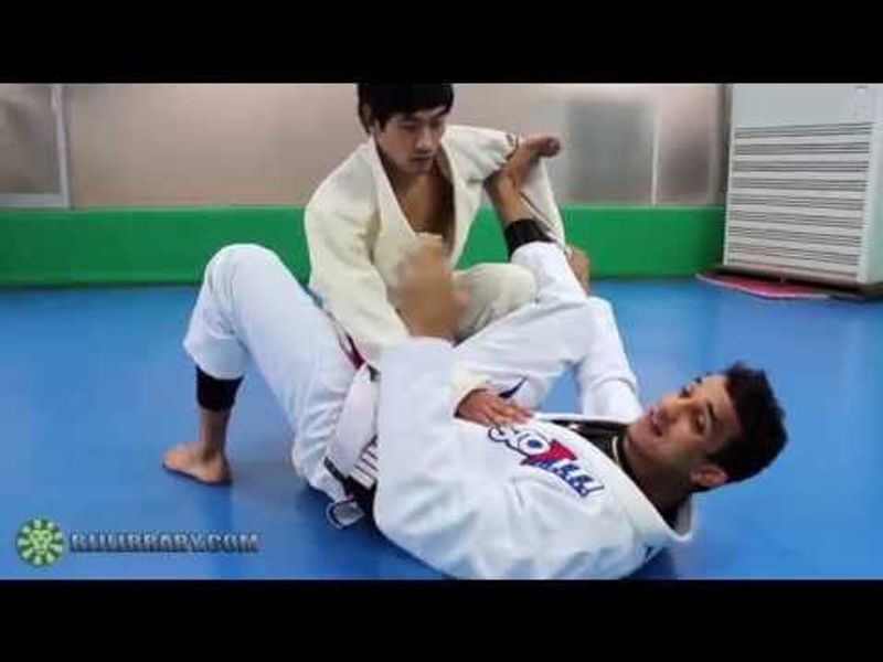 Brazilian Jiu-Jitsu lesson: Romulo Barral -- scissor sweep from spider guard to triangle