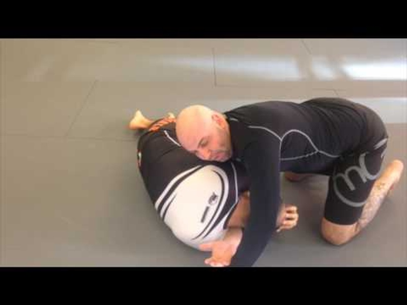 BJJ: Learn how to sink the inverted arm triangle from the knee-on-belly