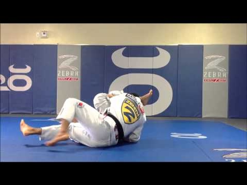 Brazilian Jiu-Jitsu lesson: Mikey Musumeci teaches how to apply an omoplata from the berimbolo