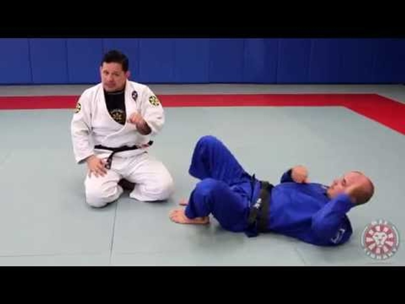 Brazilian Jiu-Jitsu lesson: how to defend an armbar from guard