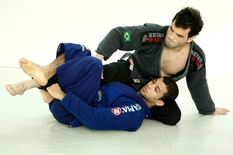 With your opponent in your half-guard, reach down, grab the hem of his pants leg, and set up the X-guard