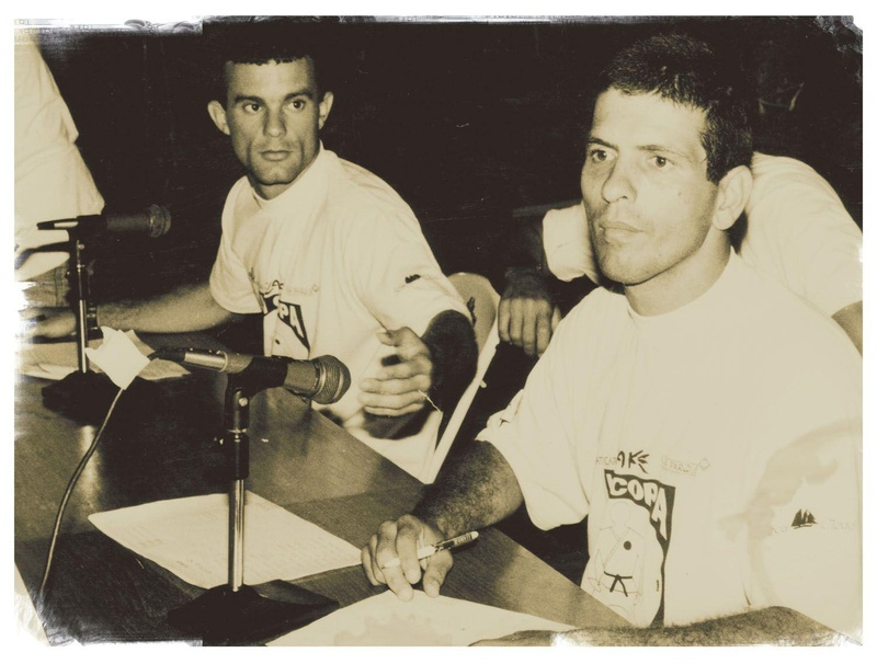 Claudio França in the background and Marcus Vinicius forward, event organizers. With the end of the Company Cup, decided to create an event in 1980 not to leave a gap for the Jiu-Jitsu competitors.