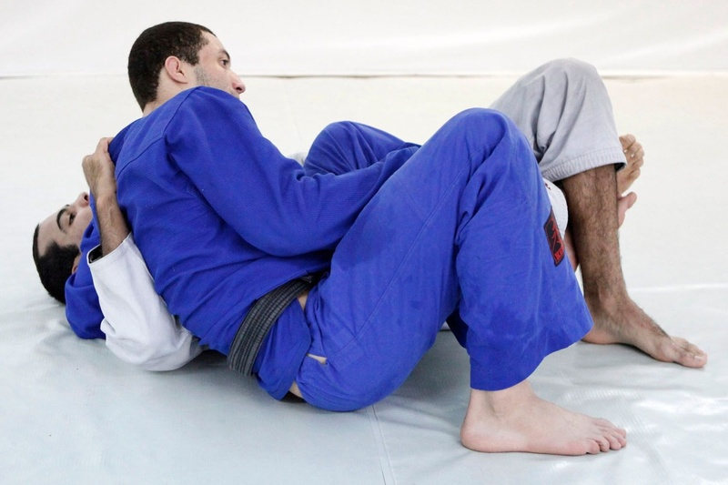 Brazilian Jiu-Jitsu lesson: Bernardo Faria teaches a deep half-guard sweep with lapel control