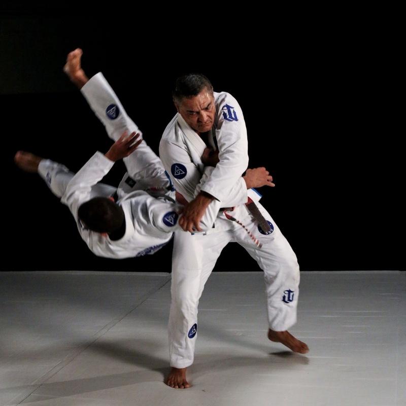 Rickson Gracie teaches: Defense to over-the-arm rear attack