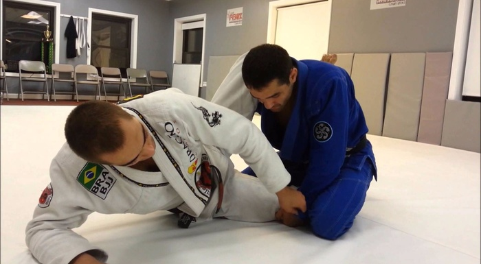 "Brazilian Jiu-Jitsu techniques: Luiz Panza teaches how to ""float"" the hip for choke with a triangle"