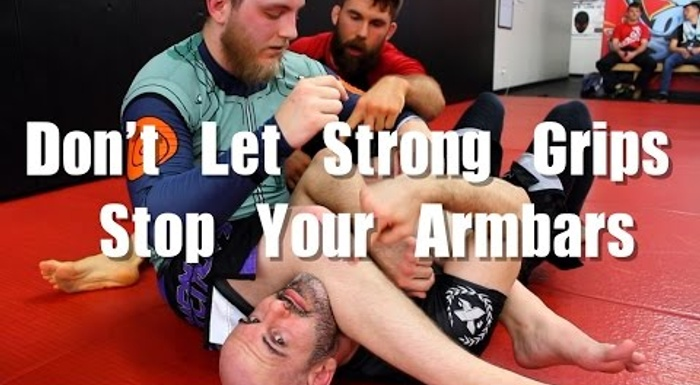 2 ways to break the grip to sink the armbar in BJJ