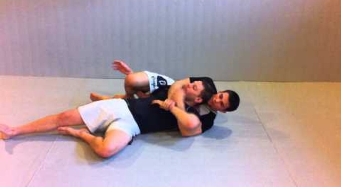 BJJ lesson: Garry Tonon teaches a guillotine starting from the back-take