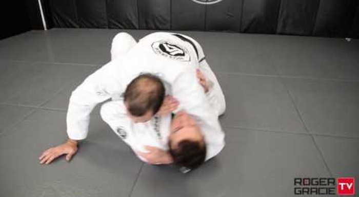 BJJ: Roger Gracie shows how to beat the butterfly guard to gain the mount