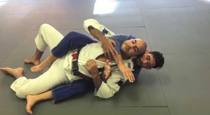 BJJ lesson: Matheus Diniz teaches how to sweep from half-guard, take the back and choke