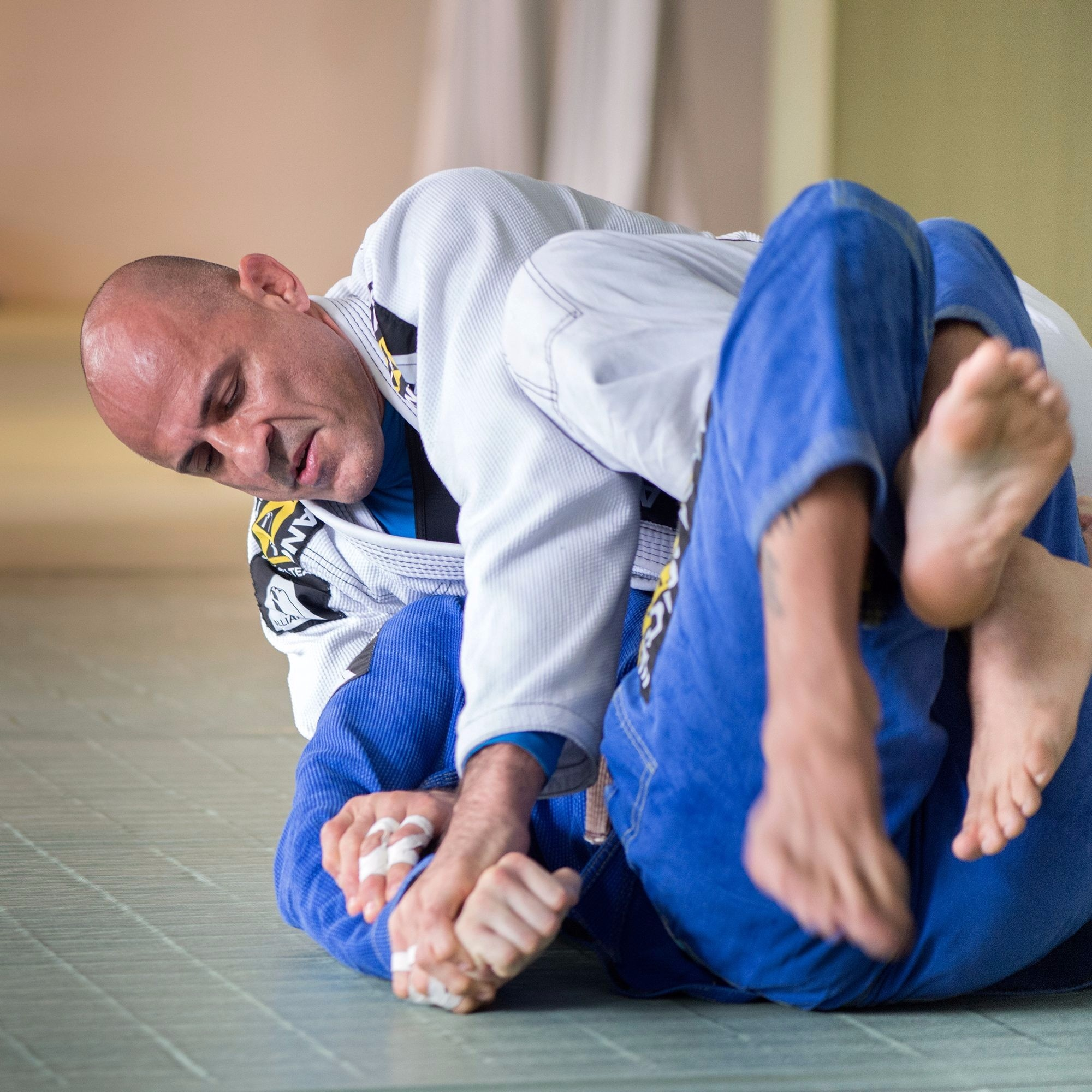 "1999 Brazilian Jiu-Jitsu World Champion Alexandre Paiva is a co-founder of BJJ powerhouse Alliance and the chief instructor of Alliance Leblon, RJ. He graduated several world champions such as Fernando Tererê and Leo Leite. Get to know more about ""Gigi"" <a href=""http://www.bjjheroes.com/bjj-fighters/alexandre-paiva"">here</a>."