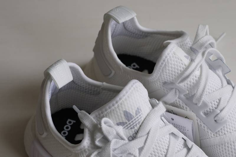nyhubo Adidas NMD R1 Triple White 1.0 (#935785) from EPHBEH at KLEKT