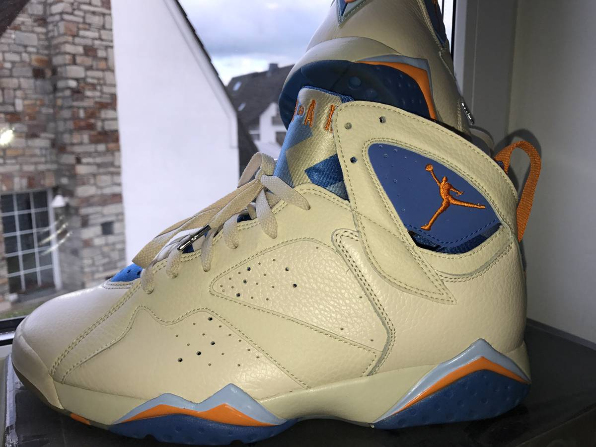 b49db0723d1d ... Air Jordan 7 (VII) Retro – Pearl White   Bright Ceramic – Pacific Blue  ...