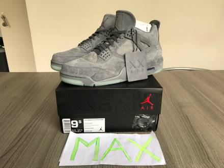 Nike Air Jordan Retro 4 x KAWS (AJIV) - photo 1/7