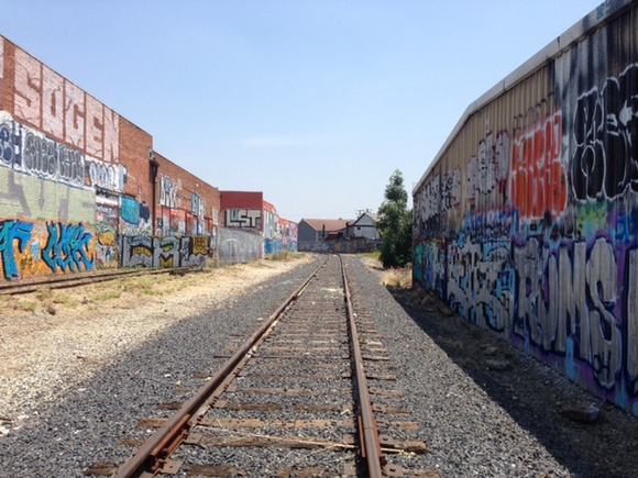 Outdoor Alley with Graffiti Walls and a Railroad nearby. Available 7 days a week from 7AM to 7PM. Additional cleaning fee depending on the type of production. IMPORTANT. Week day rate: 1 hr only - $300, Hr rate (from 2 to 4 hours) - $200, 5 hr rate 8AM-12PM - $800, 5 hr rate 2PM-7PM - $800, 8 hr rate 8AM-4PM - $1500, 11 hr rate 8AM-7PM - $1900. Week end rate: 5 hr rate 8AM-12PM or 2PM-7PM - $1500, 8 hr rate 8AM-4PM - $1900, 11 hr rate 8AM-7PM - $2500.