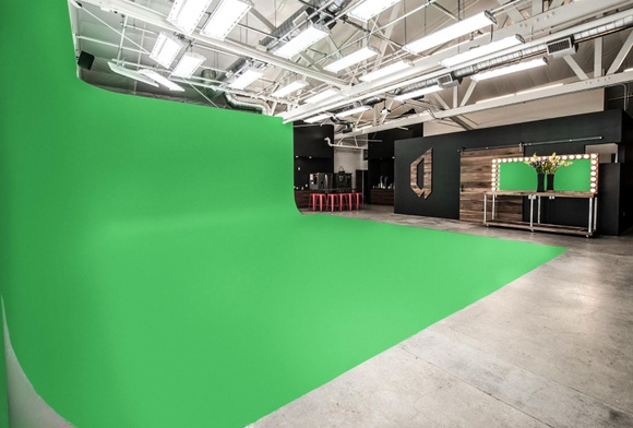High end finished open plan photo studio and production stage with kitchen, lounge, large cyclorama and additional conference room and editing suite.