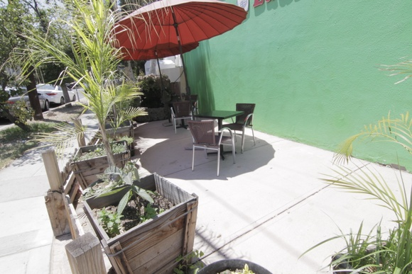 Patio outside of a coin laundry. Different Rate for Business hours Sun-Mon 7am to 10pm: $500/hour (min 3 hours) $350/hour (more than 3 hours)