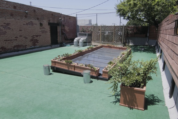 A 30s style warehouse exposed ceiling with skylights. Separate level with many architectural characteristics. Beautiful garden area. Private outdoor rooftop patio. 2 Floors.