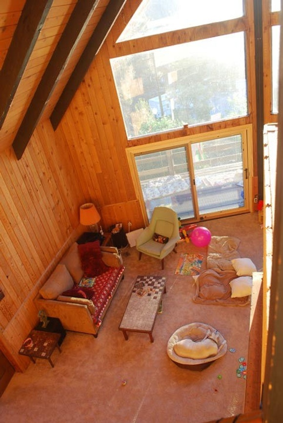 Only 1,5 hours from Los Angeles.  A large sun-filled living /dining room with pine vaulted ceilings and floor to ceiling windows. Spacious three-level home/cabin style. View the gorgeous mountains/forest through the windows/sliding glass doors or enjoy immaculate views from one of several decks. Downstairs in the full size family room, with brick fireplace and upright piano. The top floor features the master bedroom with a King-sized bed, a full-bathroom and a private deck. The main floor with the kitchen/ living room has two bedrooms - one queen, one with two twin beds and a second bathroom. The bottom floor is like a private apartment - a King-sized bedroom, a full bathroom, and the family-room/fireplace with sliding doors that lead out to the spacious back yard.