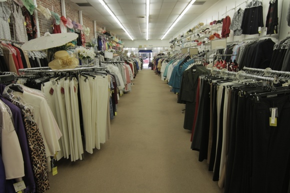 Store with 3 fitting rooms, upstairs area, storage and restroom.