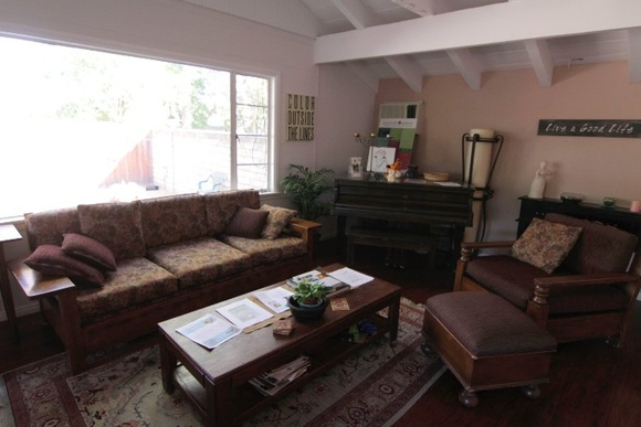 Beautiful center for Mind, Body and Spirit. 3 Bedroom House that no one lives in, has spacious front, side and back yards. One room cannot be used - chiropractor's office. The rest includes main room (living), kitchen, 2 therapy rooms, guesthouse that is a learning room for children, 2 bathrooms.