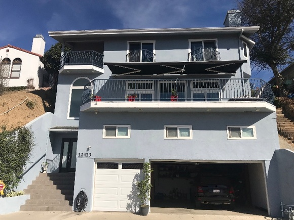 Step into this comfortable, spacious, custom, executive, 3 story OPEN space home with 180 degrees views on each floor. Family room with sitting area, Baby Grand Piano and modern Bar counter. Garage. Built in 1996. Limited Street parking, check during the scout.