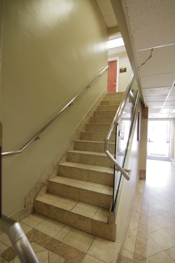Hallways and Stairs in an Office Building. IMPORTANT. STATED RATES ARE FOR 8 HOURS during week days only (any time from 8AM to 6PM), for more than 8 hours, weekend or after hours STUDENT AND INDIE rate becomes: 12hour day - $1125, after hours or weekend - $1500. Any project that is after 6PM or on weekends requires a staff member and a security personal to be present for extra pay. Access to electricity is stipulated for each production (minimum fee is $ 300).