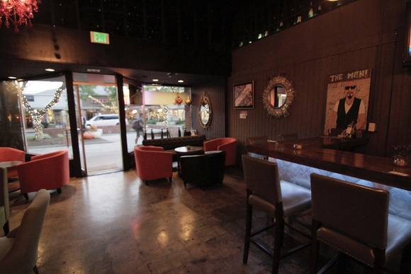 Cozy Wine and Lounge Bar. Main area, backyard, 2 restrooms. Business Hours: 5PM-Midnight. Closed on Sundays. Allows closedown for extra pay. Walls painting and making holes in the walls has to be negotiated prior to the shoot.