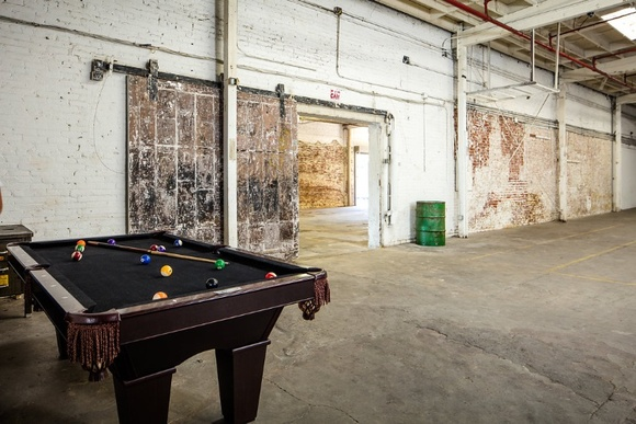 Huge Warehouse, in a very quiet area. Three Studios. 1 Studio - 5,000 total sq ft, 17' ceilings, drive-in loading, 6 skylights, exposed brick, original vintage details, blackout available, private hair + makeup room, green room + lounge, free wireless internet, 2 private restrooms + shower, equipment + prop rentals, parking. 2 Studio - 5,000 total sq ft, 16' ceilings, drive-in loading, no skylights, exposed brick, hair + makeup area, free wireless internet, 2 private restrooms, equipment + prop rentals, parking. 3 Small Studio - 578 total sq ft, white brick + wood walls, free wireless internet, 2 private restrooms, equipment + prop rentals, parking. All studios can be combined.