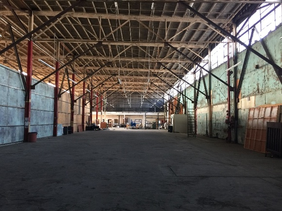 Open warehouse stage with 22ft high grid and a 32ft high ceiling. Unique color and style.