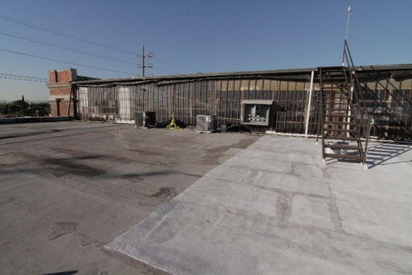 Grey rooftop with metal bar windows. Great view. Holding area, makeup station available.