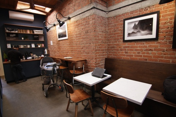 Third Wave Coffee Shop With Rustic Modern Vibe Exposed Brick Skylights Back