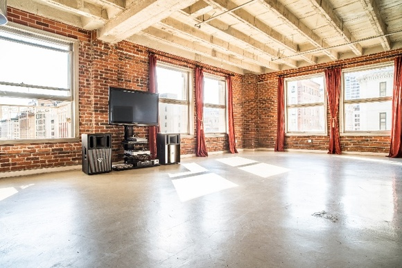 Floor lever 10. Open floor plan loft, featuring brick walls, concrete floors, art deco balcony and two walls of windows bringing an incredible amount of natural light. High end modern and antique furniture, as well as large variety of props.