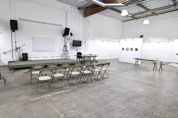 Modern art gallery with 20 ft high walls. Large beams within the insulated ceiling. 8' x 16' stage and professional PA system for concerts, etc. Reception area, small storage area, gift shop, 3 artist studios and 32' x 20' open space. 6 floating 8' x 8' T-walls for displaying art with lighting. 100 folding chairs and 17 folding tables on-site. Acoustics are excellent. Center has an industrial feel. If an exhibit is up, we prefer to leave it, but it can be removed with previous notice. Details and/or fees are applicable.