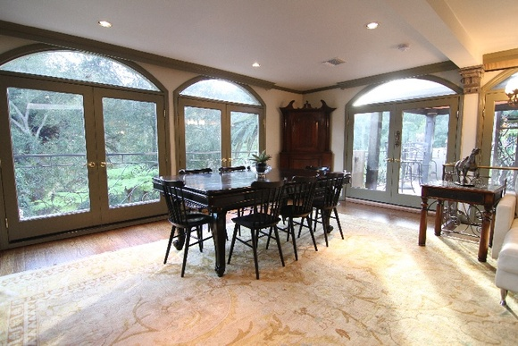 The house features an open-plan kitchen, 4 large bedrooms, 4 granite bathrooms, 3 fireplaces. Dramatic three-story waterfall, century-old palms and exotic trees, canyon views, one hour of hiking trails, pool, spa, BBQ patio, 7 gazebos, terraced gardens, Koi pond and parking for 80+ cars.
