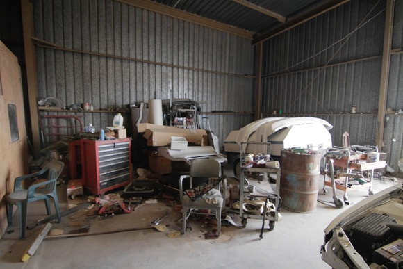 Auto Repair shop, Junk yard, Office, lots of open space   in the middle of the desert. About 90 mil from Los Angeles, CA.
