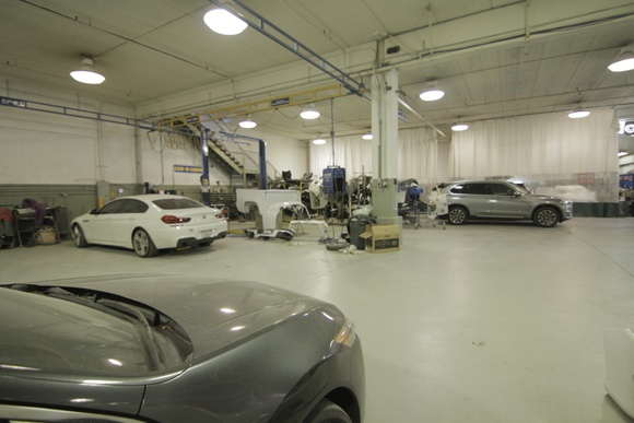 Auto Body Shop - huge open floor, paint booth, automotive tools and equipment. Tire equipment, lifts.