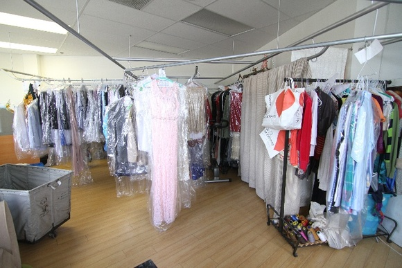 Dry Cleaning Store with clothing racks and two large counters to receive drop offs. There is also a changing room, a sewing desk and a professional iron board. Business Hours: 9AM-7PM. Rates stated are for non-business hours only. To close down you have to pay the stated rate plus $1000.